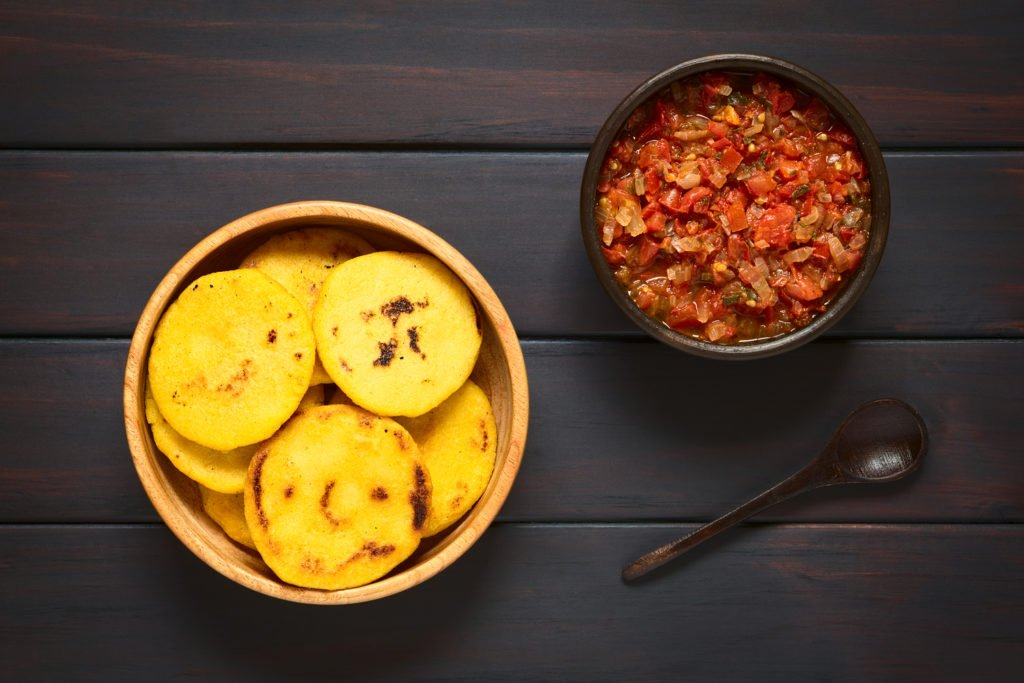 Arepas with hogao sauce, food of Colombia