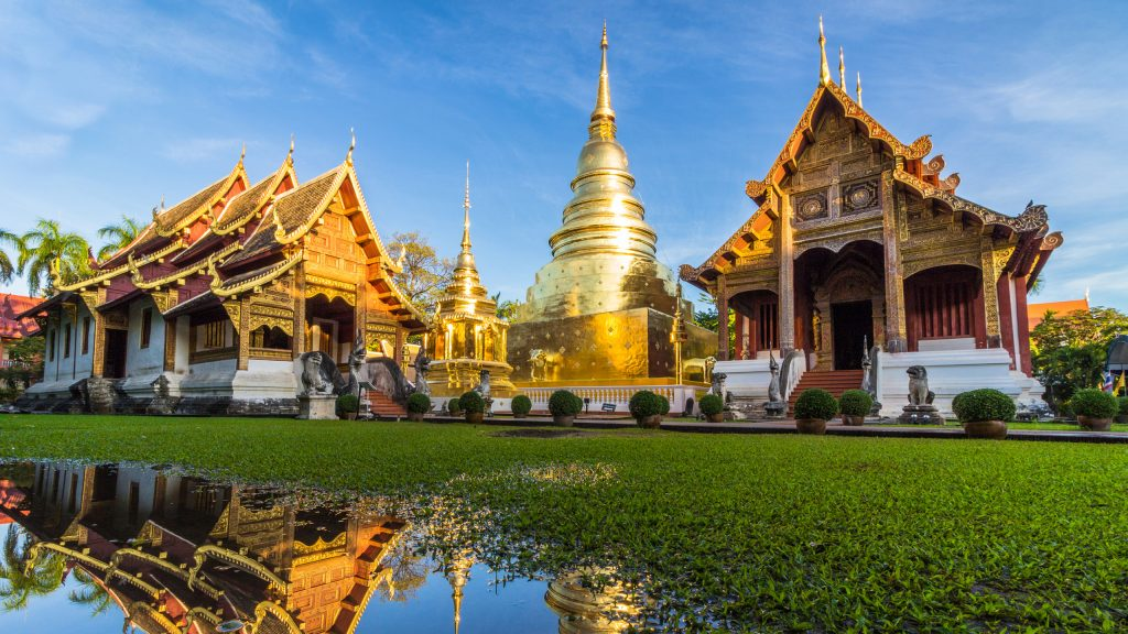 Wat Phra Singh temple and reflection in water. Chiang Mai