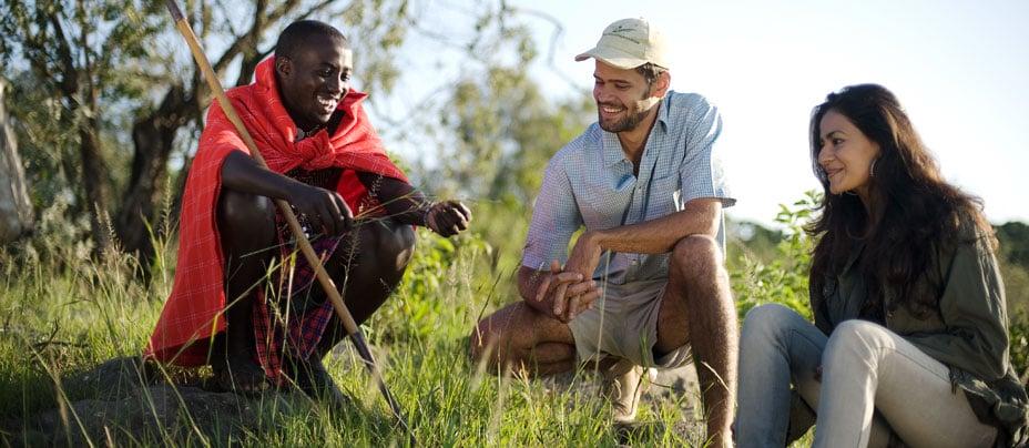 Maasai guide with couple, Kenya