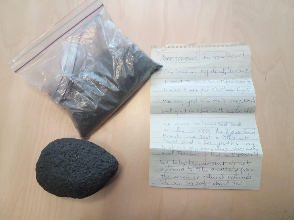 The tourists returned the sand and pebble with a note.
