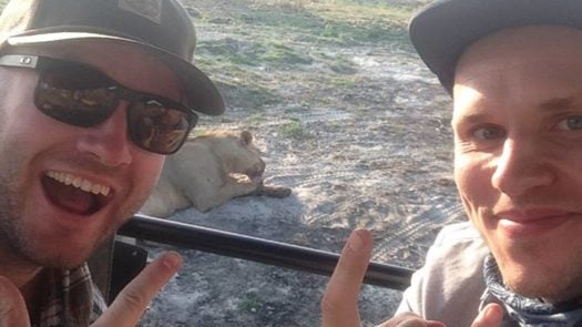 Byron and George lion selfie on safari
