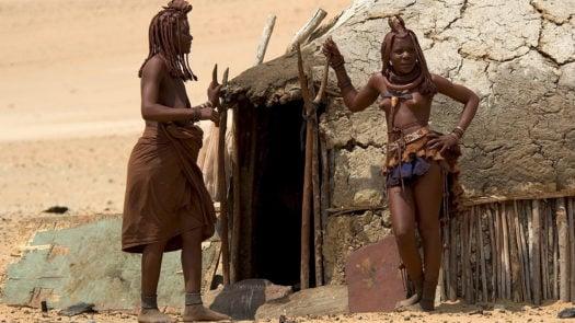 Two native women by a dwelling, Serra Cafema, Kunene River, Harmann's Valley, Namibia
