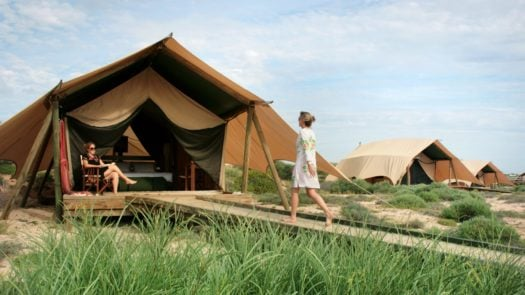 Woman walking into tent, Sal Salis, North West Australia