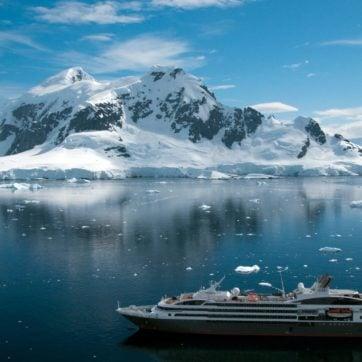 Antarctica iceberg with cruise ship
