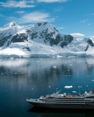 Antarctica iceberg with cruise ship