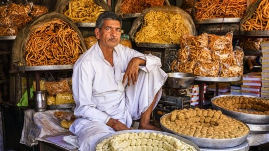 Indian street vendor selling sweets