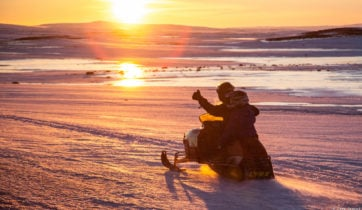 Snowmobiling in Midgard, Iceland