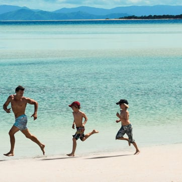 Family running along the beach, Hayman Island