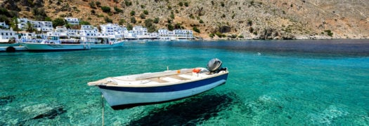 Motorboat at bay of Loutro town on Crete island