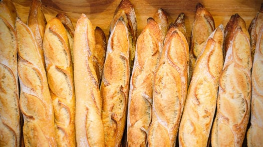 Bakery in France with fresh baguettes or breads on shelf