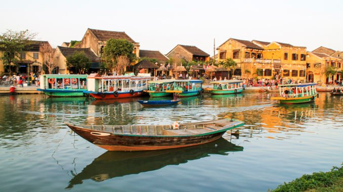 River view over Hoi An with traditional boats in Vietnam