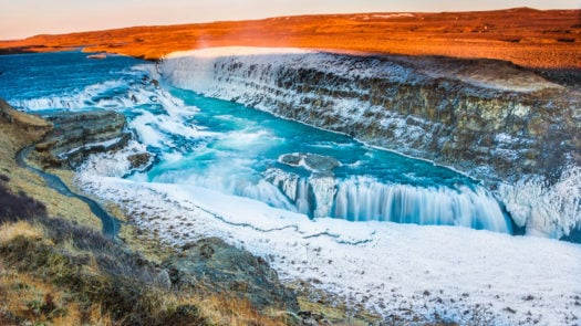 Amazing Icelandic winter landscape of majestic waterfall of frozen Gullfoss