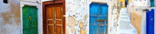 Old colorful wooden doors at the traditional village of Pirgos, Santorini, Greece.