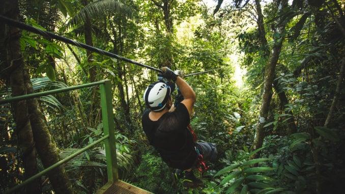 Zip-liner in the Costa Rica rainforest.
