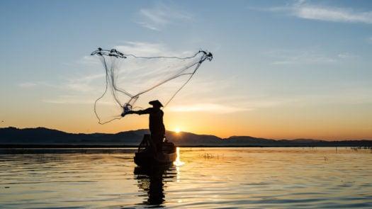 Fisherman casting net, Inle Lake, Myanmar