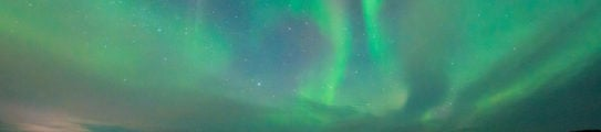 northern-lights-snowmobile-safari-swedish-lapland