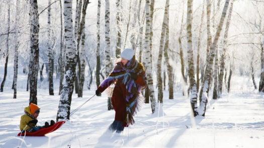 Family having fun in winter in Norway