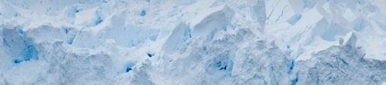 zodiac-cruising-glacier-antarctica