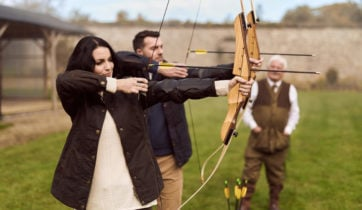 A couple learns archery at Adare Manor in Limerick