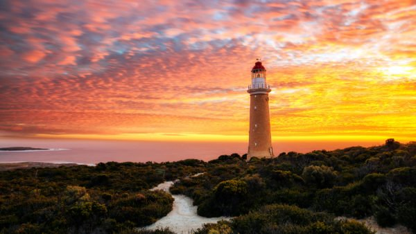The lighthouse at Cape Du Couedic on Kangaroo Island, with the sun setting in the background