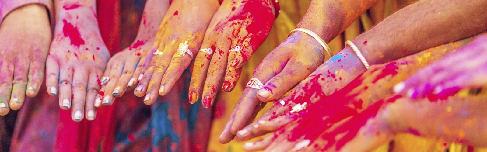 colourful hands at Holi
